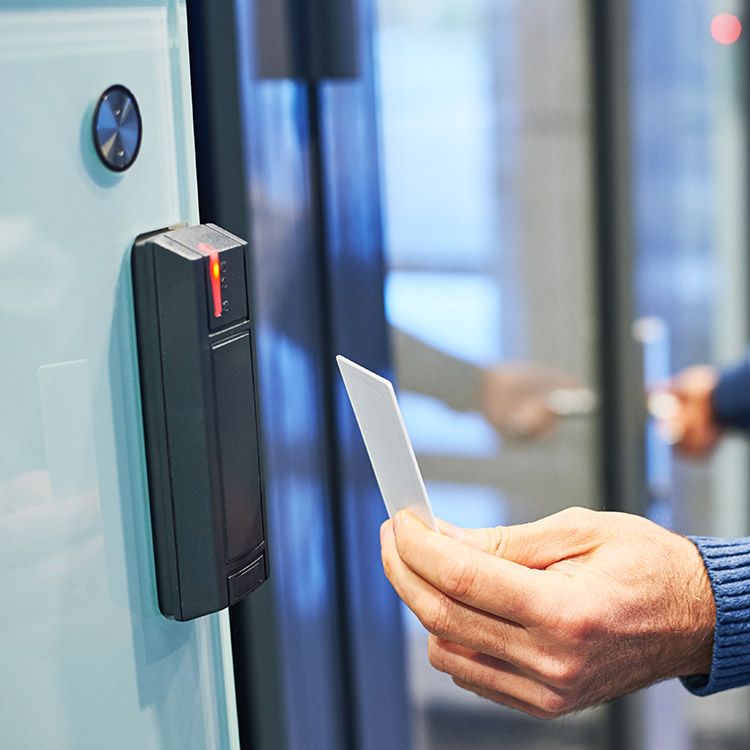 Photo of access control key card being used to gain access to a room