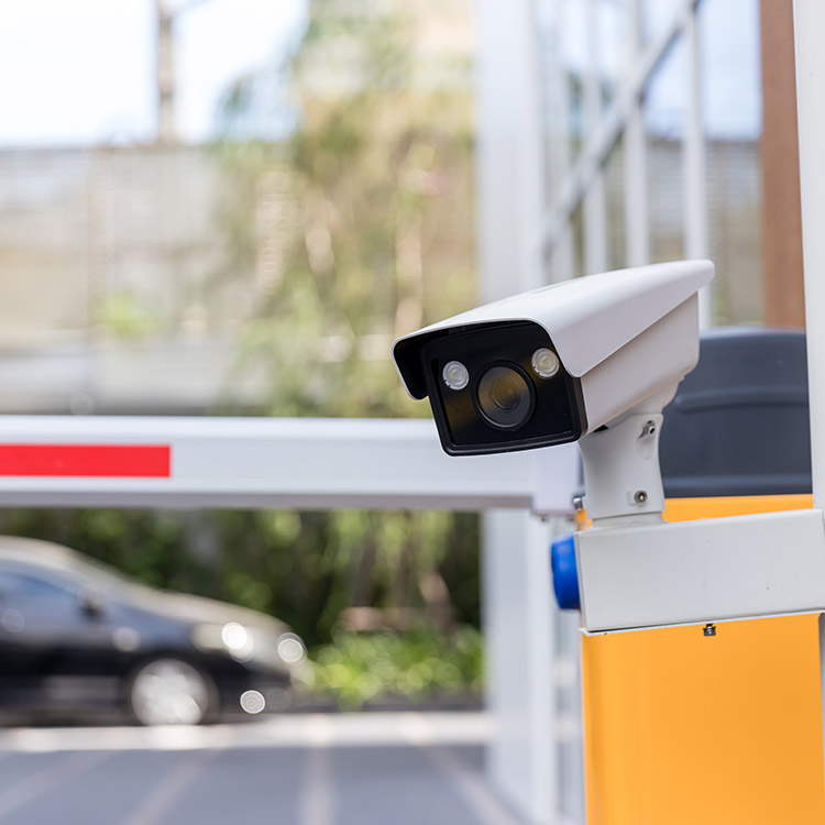 Photo of ANPR camera mounted near a car park exit barrier