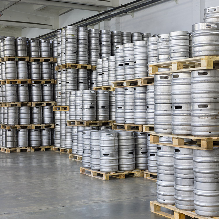 Photo of barrels stacked in brewery warehouse