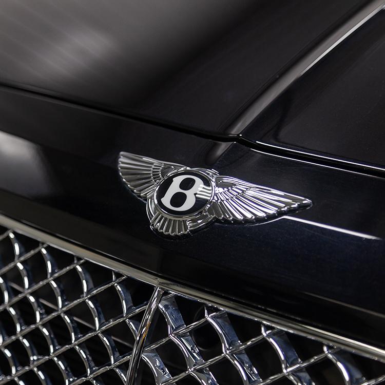 Photo of Bentley badge on a black car