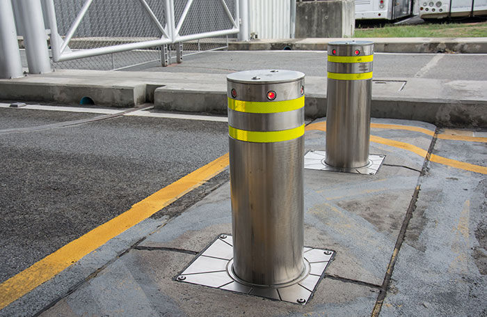 Photo of automatic retractable bollards in a road