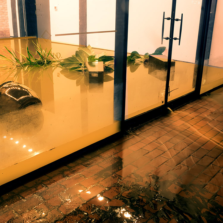 Flooded building with flood water covering the ground