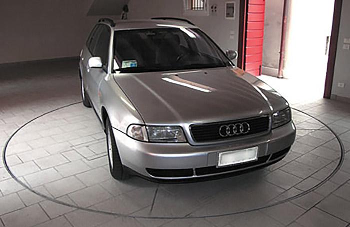 Audi on car turntable in residential garage