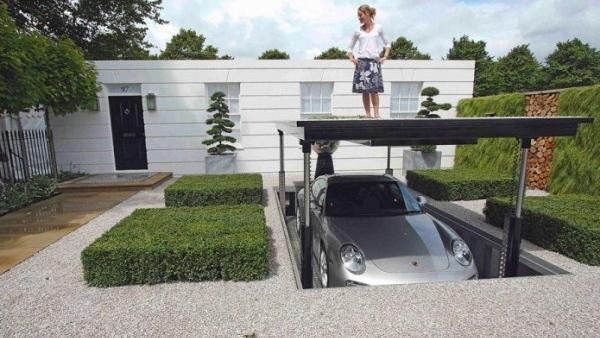 Automatic rising car lift on driveway