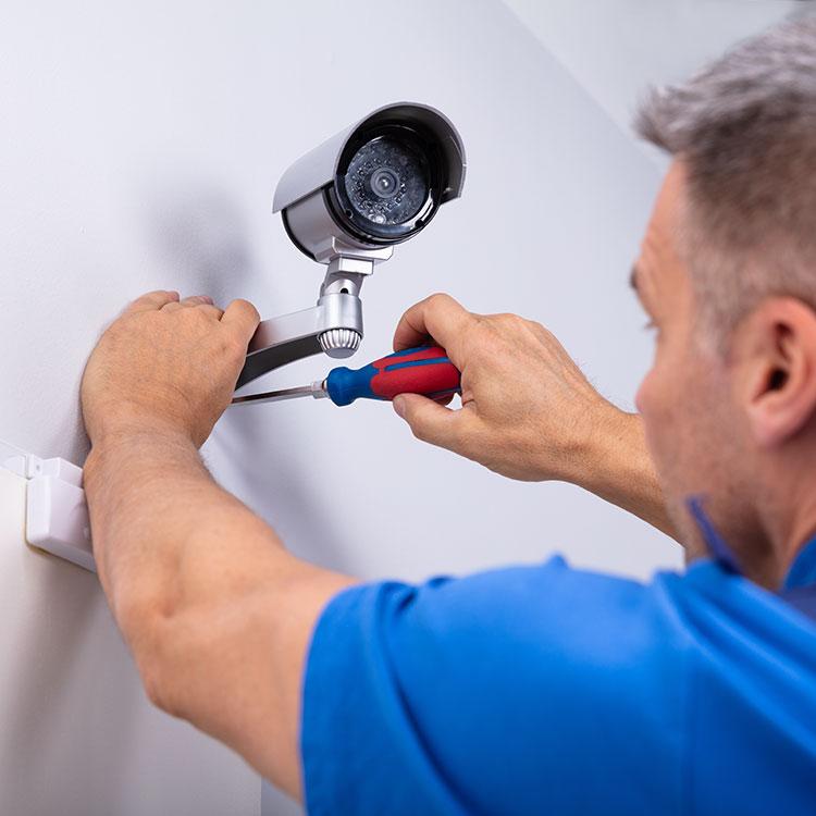 Man installing CCTV camera