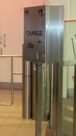 Stainless steel change machine with coin operated turnstiles