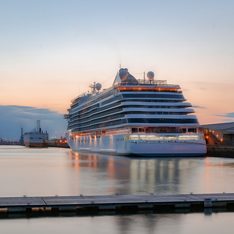 Photo of cruise ship docked at a cruise terminal