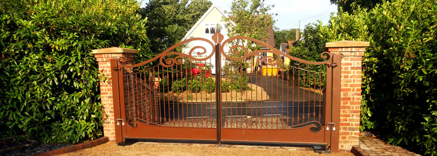 Automatic decorative gates on residential driveway