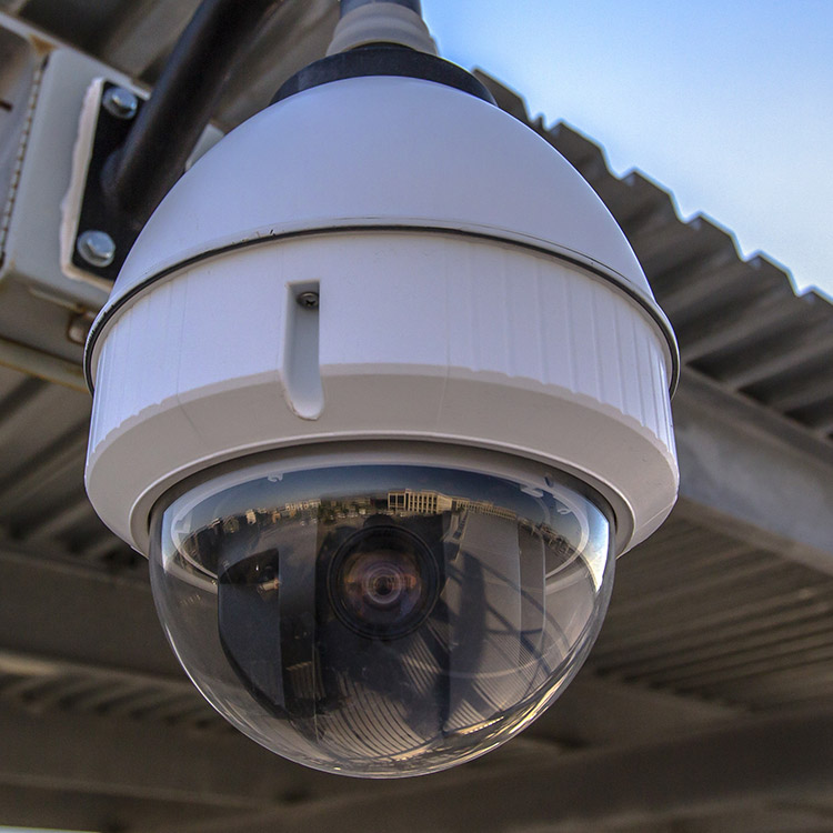 Photo of a high speed CCTV dome camera mounted under a roof