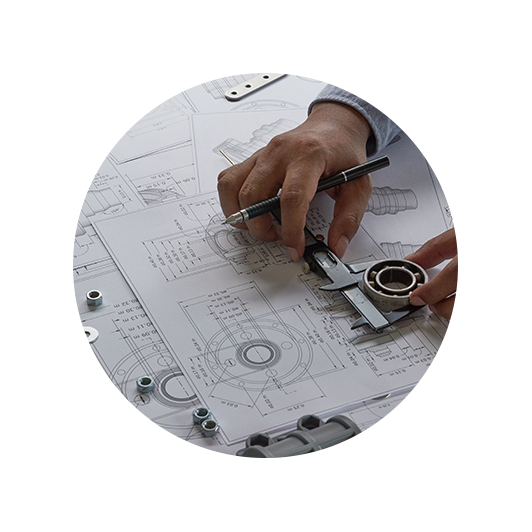 Engineer using calipers to measure size of a bearing
