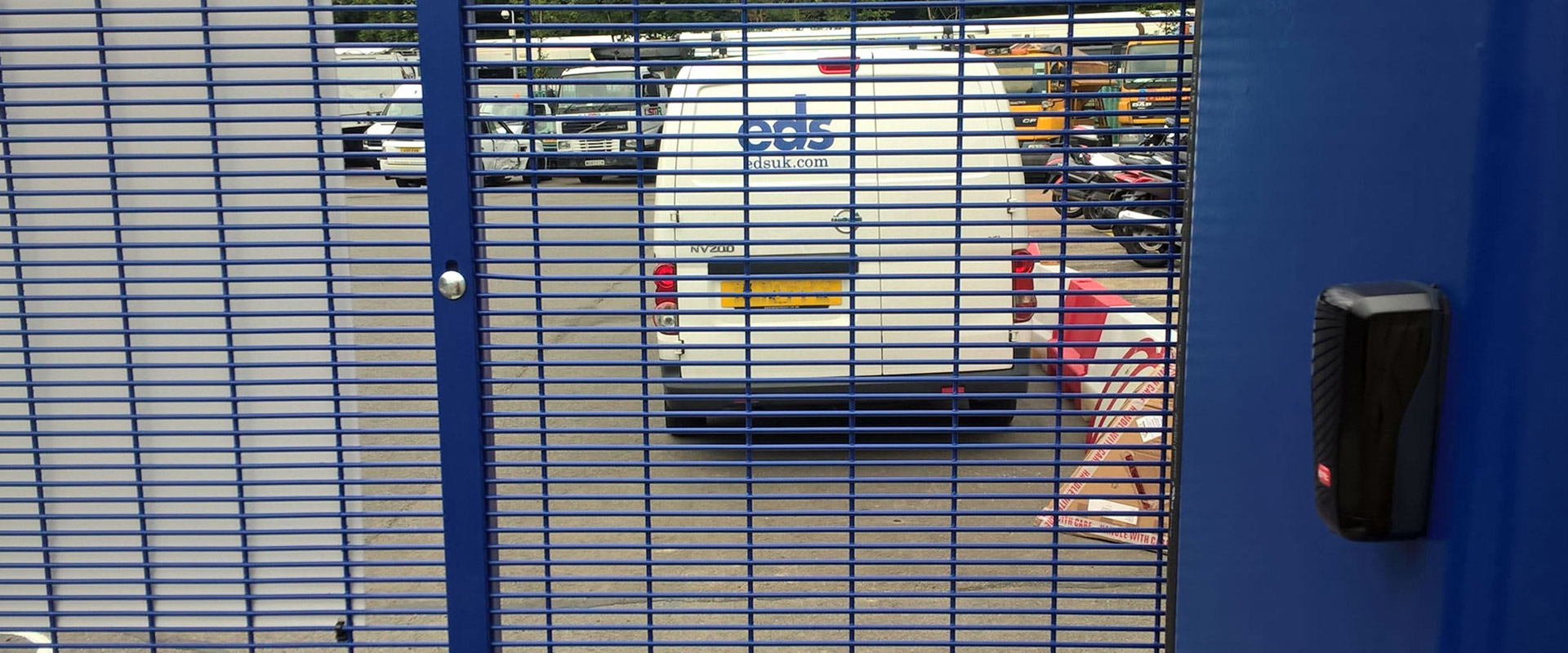 Photo looking through the mesh of the SpeedGate at a secure Metropolitan Police site.
