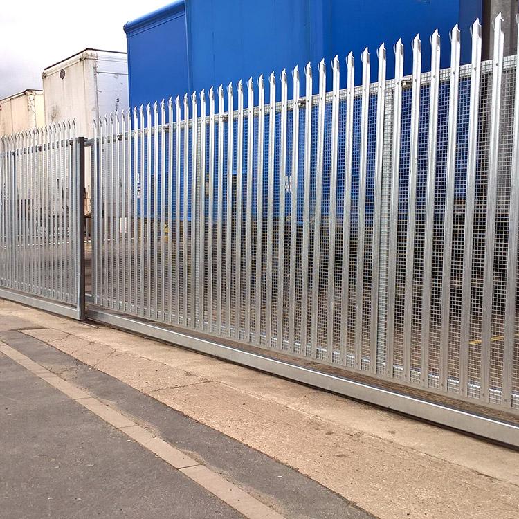 Photo of wide sliding telescopic gates at entrance of FibreLine's yard