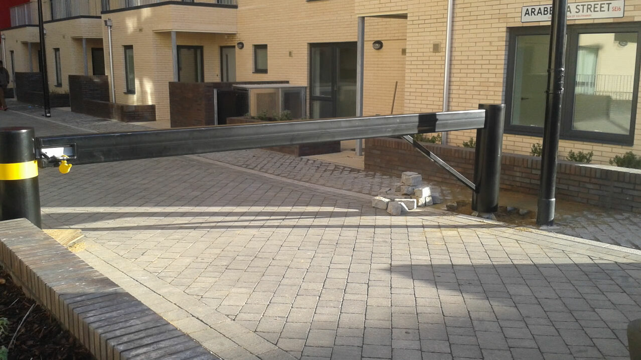 Swinging barrier controlling access to private car park