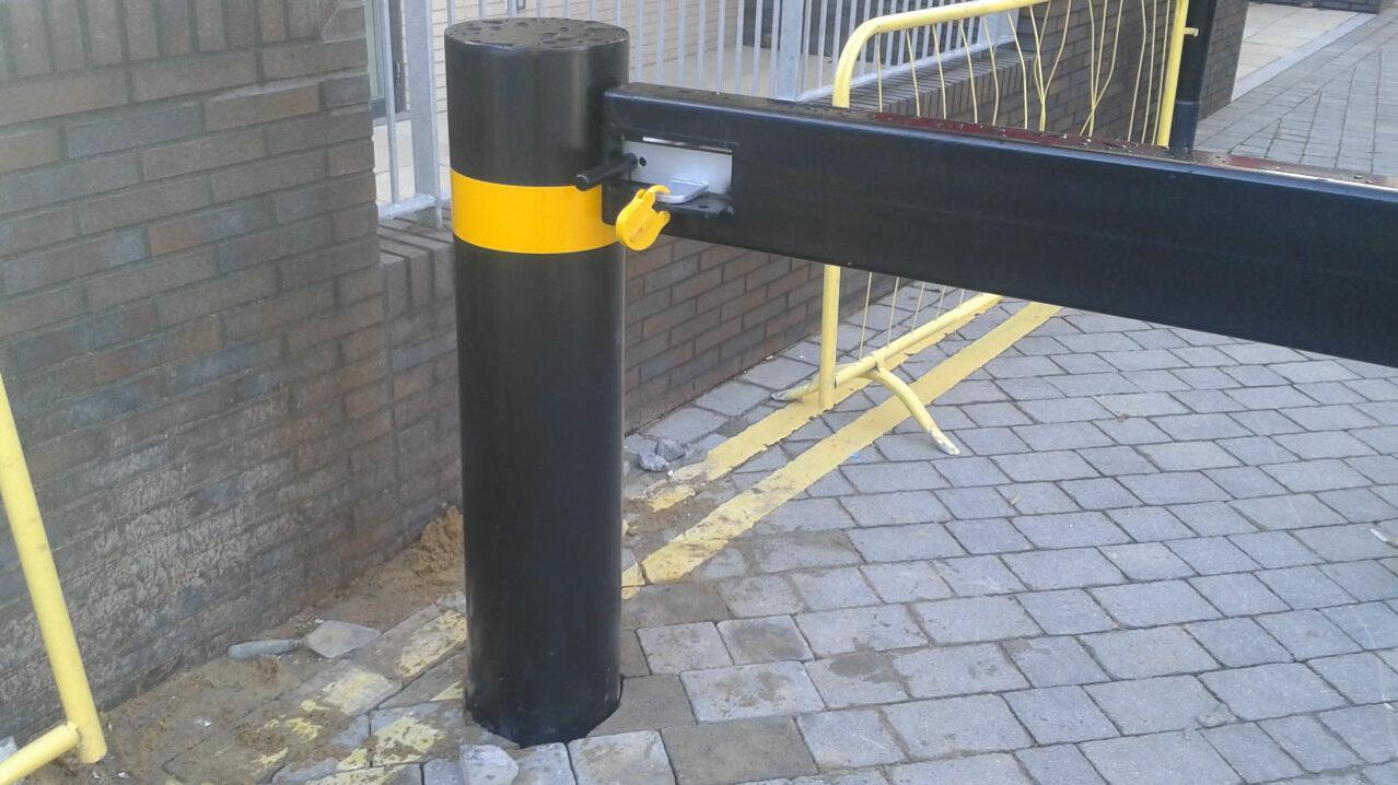 Securely locked swinging traffic barrier