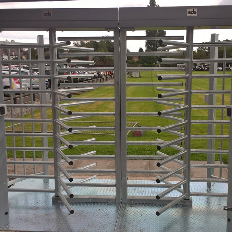 Photo of full height turnstiles at entrance to Perkins Engines site