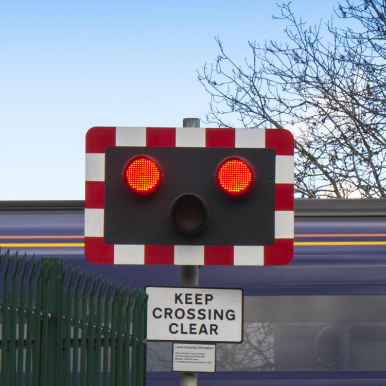 Level crossing traffic light system in operation