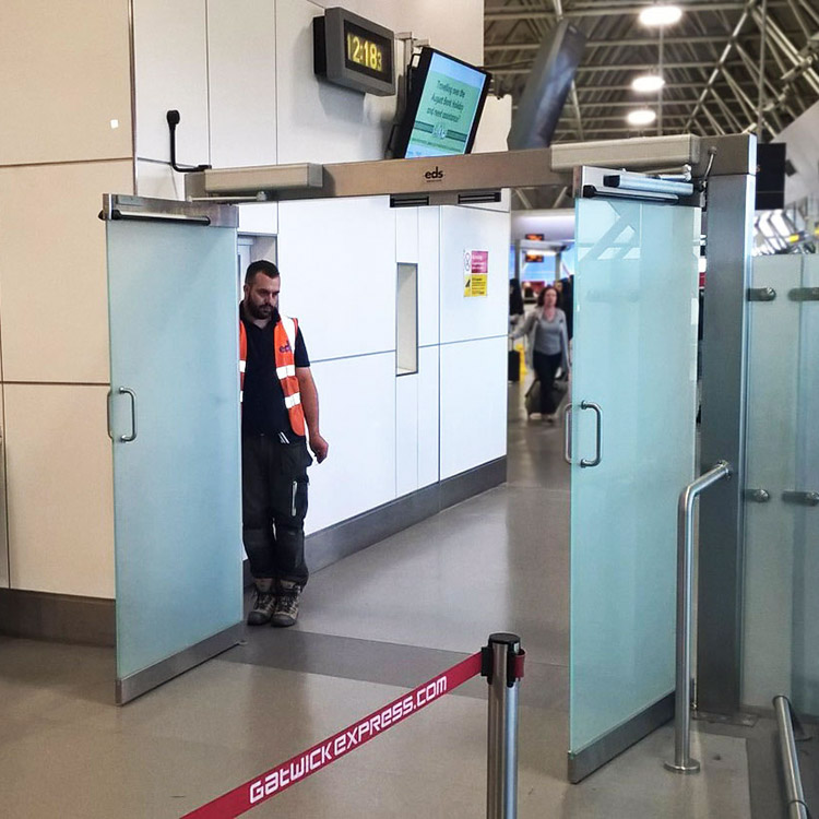 Photo of glass wall and automated glass gates installed at Gatwick Airport