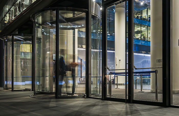 Photo of automatic revolving doors in an office building