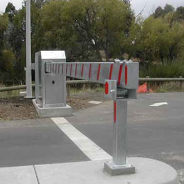 Heavy duty automatic sliding barrier in closed position across the entrance to a car park