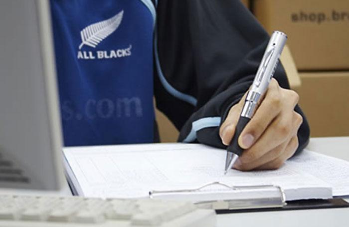 Man using digital pen camera to write