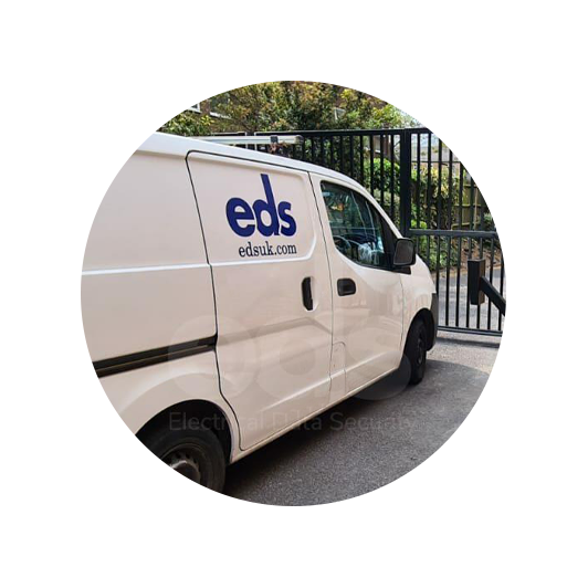 Photo of an EDS van parked outside an automatic gate
