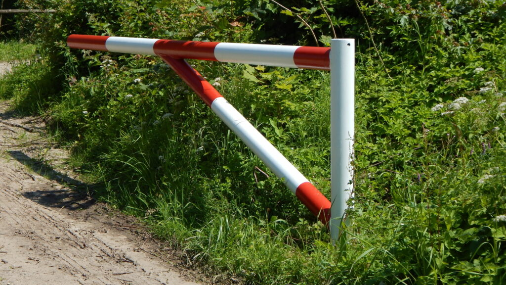 Open swinging barrier allowing access to rural road