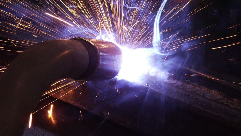 Photo of a welder working on a project
